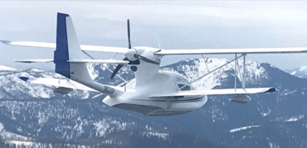 Super Petrel LSA Daisy flying over the Rocky Mountains